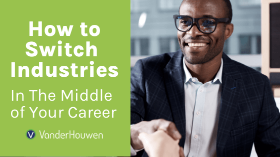 How to Switch Industries in the Middle of Your Career | Black man in a suit and glasses shaking someone's hand