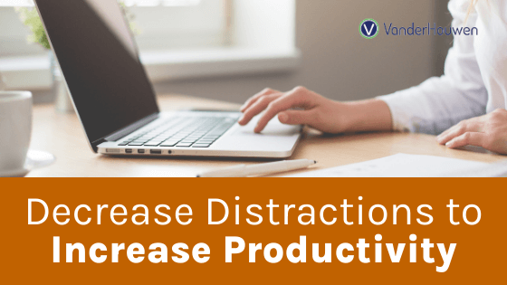 Decrease Distractions to Increase Productivity | Woman's arms sitting at a desk with a laptop