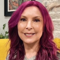 Woman With Pink Hair Smiling At The Camera